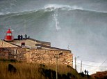 Monster wave: Garrett McNamara is said to have broken his own world record for the largest wave ever surfed when he rode this 100ft crest in Nazare, Portugal