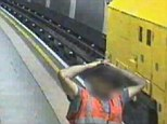 Out of control: The man puts his head on his hands as the train hurtles through the underground during one of the busiest times of the day