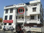 Jump: The British woman leapt from a second floor balcony (circled) of the Hotel Agra Mahal at the centre of the city