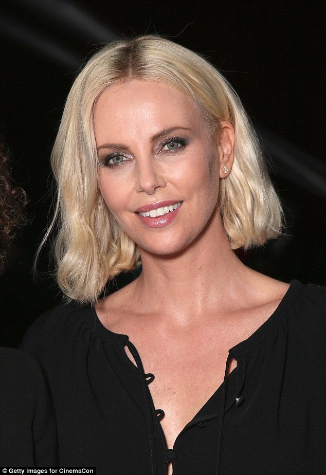 black medium hair styles charlize theron wears a chic black frock to introduces 3328